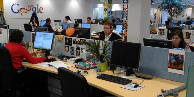 Employees work in one of the open space work areas in the offices of Google, at their European headquarters...