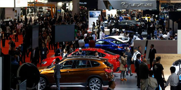 Vehicles produced by Bayerische Motoren Werke AG (BMW), front, and Toyota Motor Corp.'s Lexus unit, rear,...
