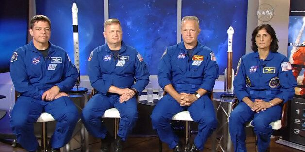 In this image made from video provided by NASA, astronauts, from left, Bob Behnken, Eric Boe, Doug Hurley...