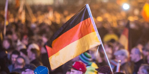 Protestors attend a demonstration of the PEGIDA (Patriotic Europeans against the Islamization of the...