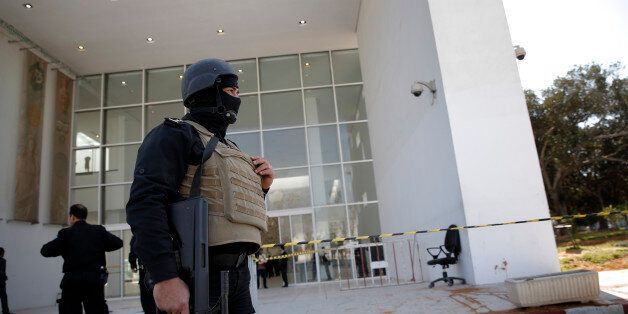 Policemen guard the entrance of the Bardo museum in Tunis, Tunisia, Thursday, March 19, 2015, as a a...