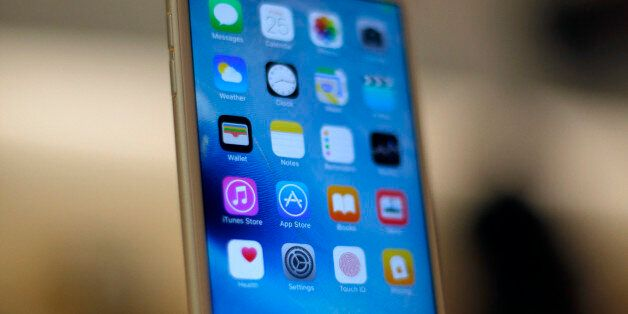 A new Apple iPhone 6S is displayed at an Apple store on Chicago's Magnificent Mile, Friday, Sept. 25,...