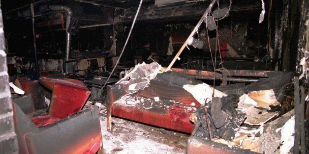 View of the burned sofas inside the topless bar and discotheque Mea Culpa, where three masked men carrying...