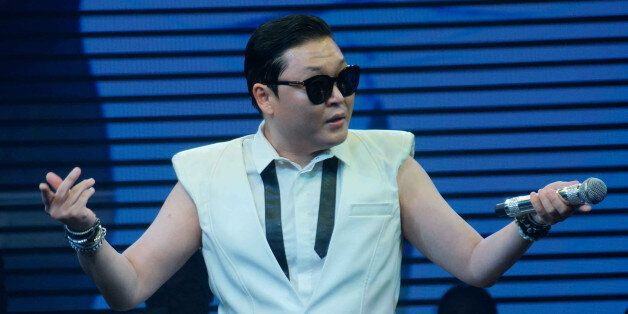 HANGZHOU, CHINA - JULY 18: (CHINA OUT) South Korean singer Psy, Park Jae-sang performs on the stage at...