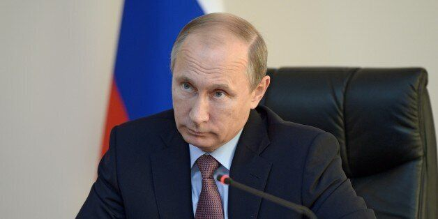Russian President Vladimir Putin attends a teleconference watching the start of the construction of a...