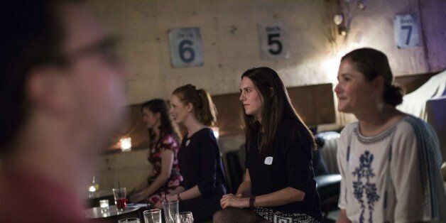 TO GO WITH AFP STORY BY EDOUARD GUIHAIREMen and women take part in an evening of silent speed dating...