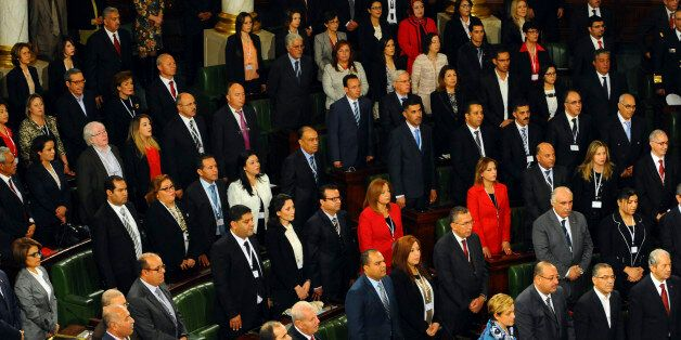 Tunisian parliament members stand during the inaugural session of the newly elected Tunisian parliament...