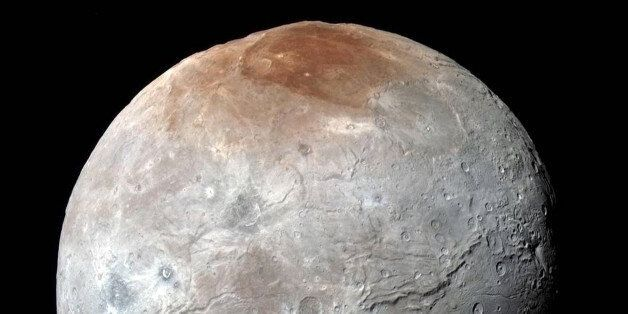 This image released by NASA on Thursday, Oct. 1, 2015, shows Charon, in enhanced color captured by NASA's...