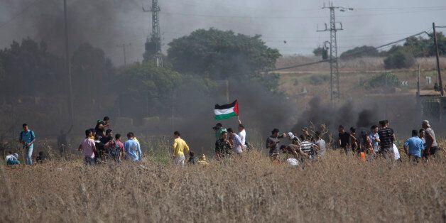 Palestinian protesters gather during clashes with Israeli soldiers on the Israeli border Eastern Gaza...