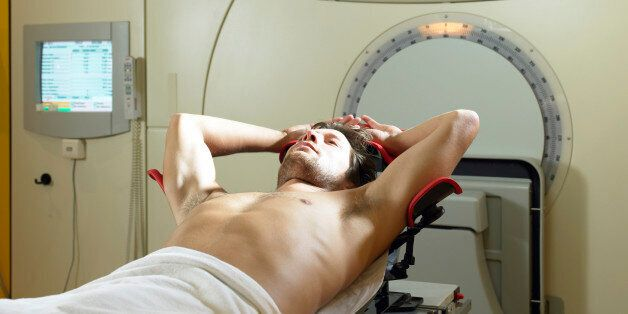 Young male patient lying on radiology
