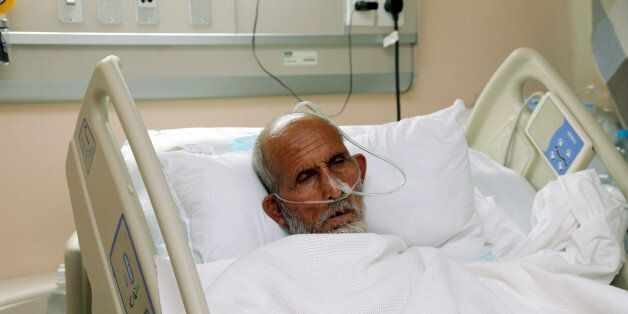 A victim who was injured in Thursday's stampede during the hajj pilgrimage in Mina, receives treatment...