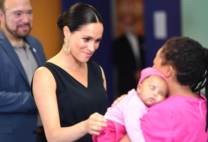 Meghan meets with 7-week-old Sumeya as she visits mothers2mothers.  The group is an African not-for-profit organization