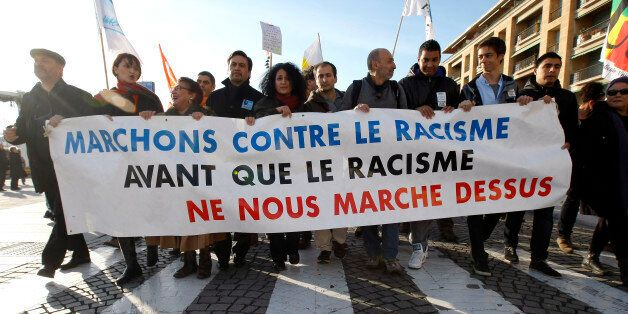 People demonstrate during a march against the racism, in Marseille , southern France, Saturday, Nov....