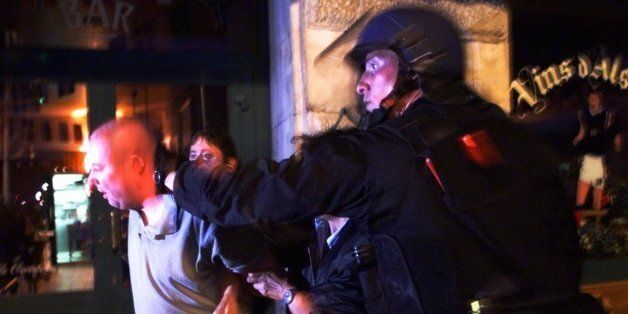 French riot police detain a British soccer fan during riots that errupted in Marseille's Old Port Sunday,...