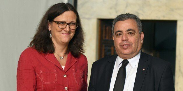 Eurpean Trade Commissioner Cecilia Malmstroem shakes hands with Tunisia's Trade Minister Ridha Lahouel...