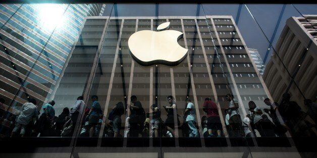 Customers queue inside an Apple store in Hong Kong on September 25, 2015. Apple was urged to act as rights...