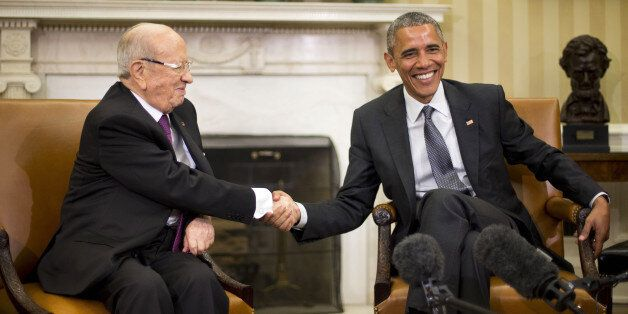 President Barack Obama shakes hands with Tunisian President Beji Caid Essebsi during their meeting in...