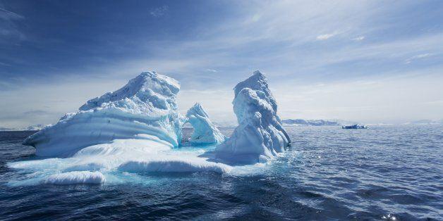 Antarctica, Massive iceberg in spring sunshine floating in Gerlache Strait along Antarctic