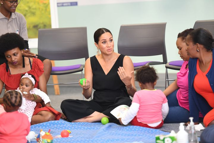 Meghan meets health workers and client families during a visit to mothers2mothers.