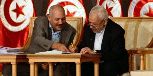 In this photo taken Saturday, Oct. 5, 2013, Tunisia's ruling Islamist Ennahda party leader Rached El...