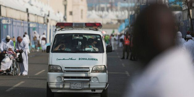 An ambulance rushes to the site where pilgrims were crushed and trampled to death during the annual hajj...