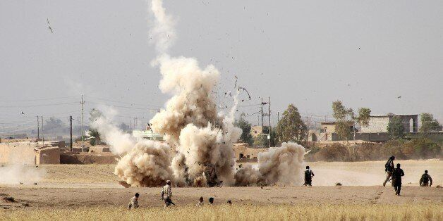KIRKUK, IRAQ - SEPTEMBER 30 : Smoke rises from minefield in Telelverid region after Peshmerga forces...