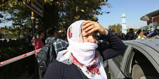 A woman reacts at the site of an explosion in Ankara, Turkey, Saturday, Oct. 10, 2015. Two bomb explosions...