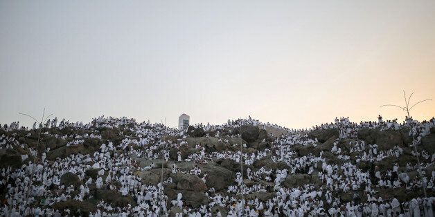 Muslim pilgrims pray on a rocky hill called the Mountain of Mercy, on the Plain of Arafat, near the holy...