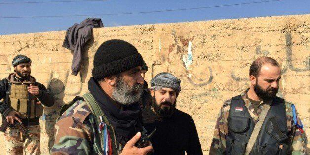 L'armée et des troupes pro-Assad, le 12 décembre 2014 dans la ville de Deir Ezzor, dans le nord-est de...