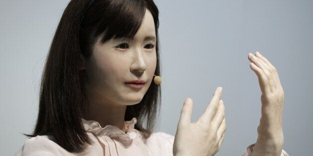 Communication android 'Aiko Chihira', developed by Toshiba Corp., performs sign language during a demonstration...