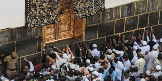 Muslim pilgrims pray at the Kaaba, the cubic building at the Grand Mosque in the Muslim holy city of...