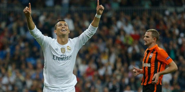 Real Madrid's Cristiano Ronaldo celebrates scoring his side's 3rd goal during a Group A Champions League...