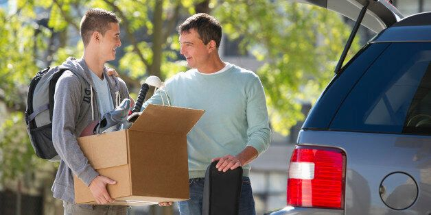 USA, New Jersey, Jersey City, Father helping teenage son (16-17) packing to