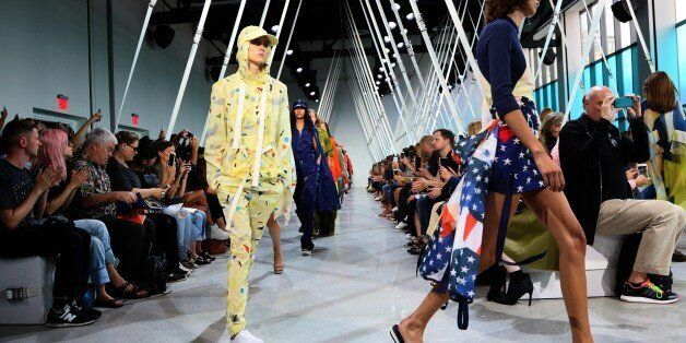 Models present designs by Lacoste during New York Fashion Week in New York on September 12, 2015. AFP...