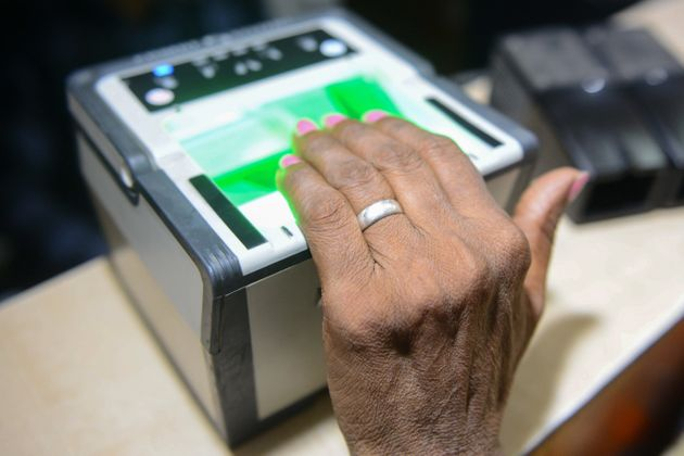This photo taken on July 17, 2018 shows an Indian woman getting her fingerprints read during the registration...