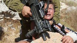 La terreur d'un enfant palestinien pris par un soldat israélien