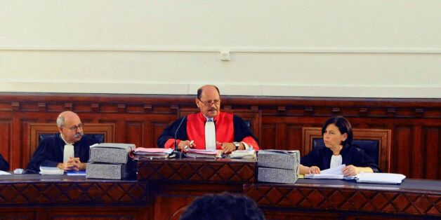 Judge Touhami Hafi, centre, chairs the Tunis Criminal Court, in Tunis, Monday, June 20, 2011, for the...