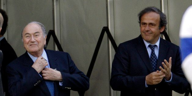 FIFA President Sepp Blatter, left, and UEFA President Michel Platini attend an exhibition soccer match...
