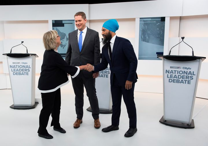 Green Party Leader Elizabeth May, left, Conservative Leader Andrew Scheer, centre, and NDP Leader Jagmeet Singh shake hands after a debate in Toronto, Sept. 12, 2019.
