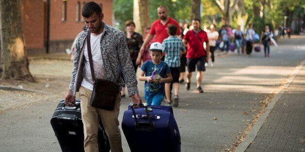 Des migrants à Berlin en toute pour demander l'asile, le 10 août