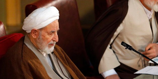 Newly elected chairman of the Iran's Assembly of Experts Ayatollah Mohammad Yazdi sits in a biannual...