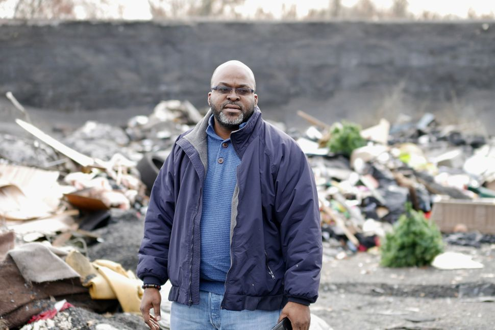 The Rev. Michael Malcom leads a faith-based environmental group and brings people to the Superfund site to see how residents