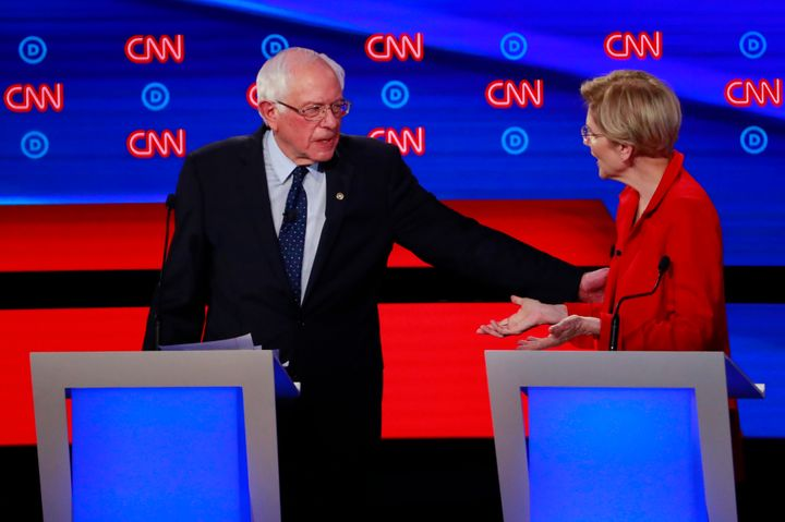 Bernie Sanders, left, greets Elizabeth Warren at the July 30 debate in Detroit, Michigan. The two candidates reportedly had a non-aggression pact that is now unraveling.