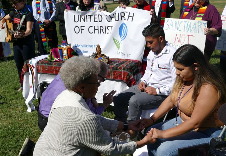 Two United Church of Christ pastors and two immigrant activists participated in a foot-washing ceremony on the Capitol lawn W
