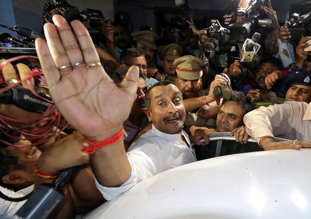Kuldeep Singh Sengar, a legislator of Uttar Pradesh, reacts as he leaves a court after he was arrested,...