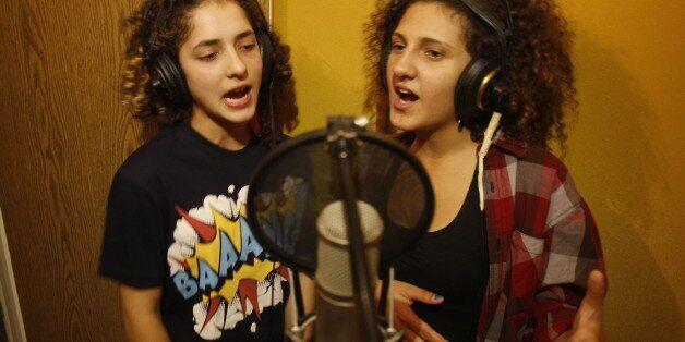TO GO WITH AFP STORY LIFESTYLE-ISRAEL-PALESTINIAN-ARAB-ENTERTAINMENT-MUSICArab Israeli youths Amani Tatour...