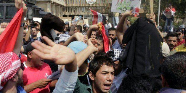 Des manifestants protestent contre les défaillances du service public irakien, le 1er août à