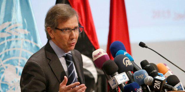 U.N. envoy to Libya, Bernardino Leon, gestures as he addresses reporters before the latest round of a...