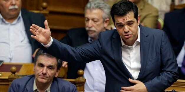 Greece's Prime Minister Alexis Tsipras delivers a speech during a parliament meeting in Athens, Thursday,...