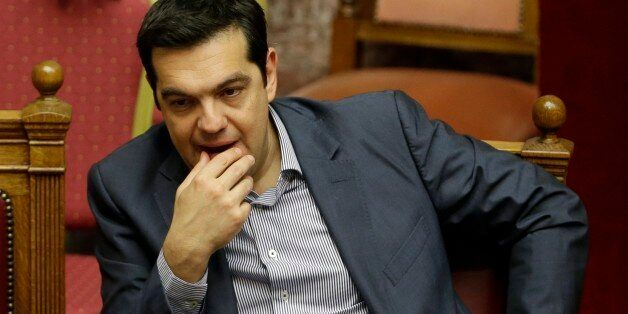 Greece's Prime Minister Alexis Tsipras reacts during a parliament meeting in Athens, Saturday, July 11,...